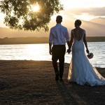 Felicity and Michael walk into the sunset after their wedding at Little Cove